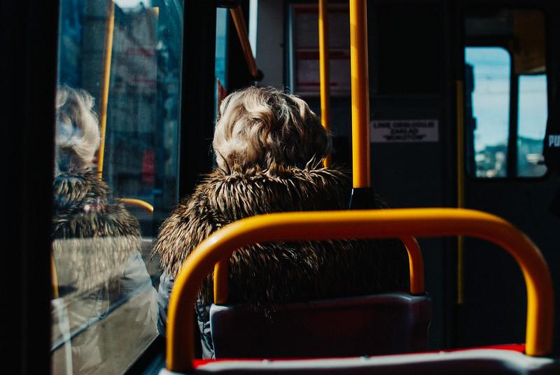 lady in tram window fur coat blond hari sunshne spring warsaw street nikon.jpg