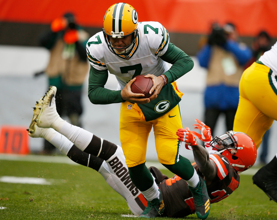 . Cleveland Browns strong safety Derrick Kindred (26) can\'t hold on to Green Bay Packers quarterback Brett Hundley (7) in the first half of an NFL football game, Sunday, Dec. 10, 2017, in Cleveland. (AP Photo/Ron Schwane)