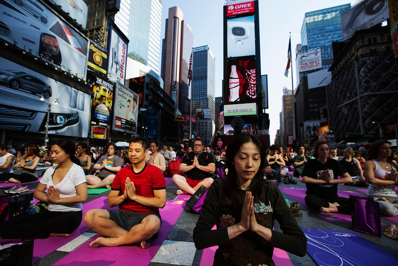 ". People take part in a group yoga practice on the morning of the summer solstice in New York\'s Times Square, June 21, 2013. The ""Solstice in Times Square\"" event on Friday brought out thousands of participants to celebrate the year\'s longest day in New York. REUTERS/Lucas Jackson"