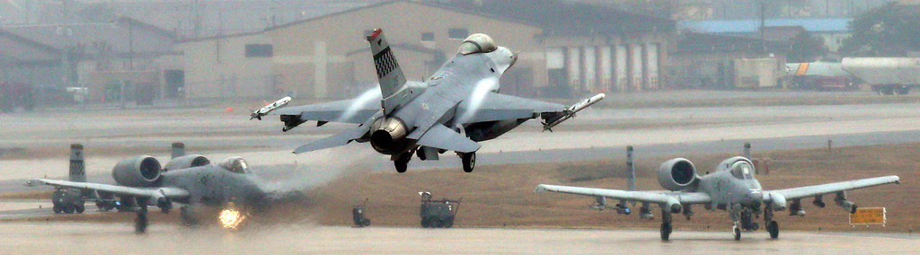 . A U.S. Air Force F-16 fighter jet, center, lands on the runway during their military exercise at the Osan U.S. Air Base in Pyeongtaek, south of Seoul, South Korea, Tuesday, April 2, 2013. North Korea vowed Tuesday to restart a nuclear reactor that can make one bomb\'s worth of plutonium a year, escalating tensions already raised by near daily warlike threats against the United States and South Korea. (AP Photo/Bae Jung-hyun, Yonhap) KOREA OUT