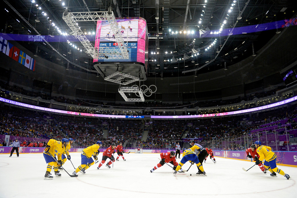 . SOCHI, RUSSIA - FEBRUARY 14: Sweden and Switzerland face off during the third period of Sweden\'s 1-0 preliminary round group C win at Bolshoy Arena. Sochi 2014 Winter Olympics on Friday, February 14, 2014. (Photo by AAron Ontiveroz/The Denver Post)