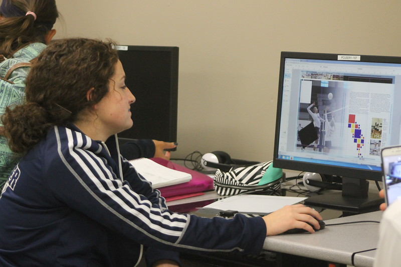 Lori Leiker employs her design skills in yearbook class.