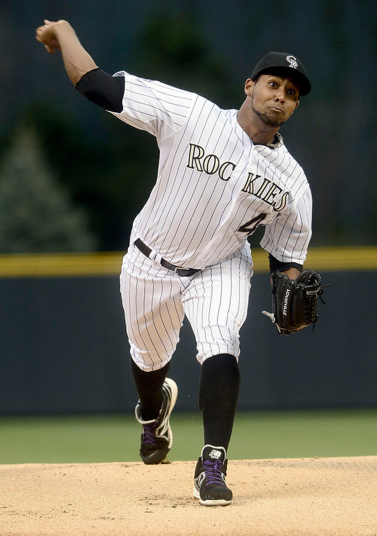 . Colorado Rockies\' Juan Nicasio pitches against the New York Yankees during their inter-league MLB baseball game in Denver, Colorado May 8, 2013.   REUTERS/Mark Leffingwell