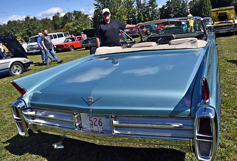 Proudly displaying his 1963 Cadilac Conv. is Timmy Sparks of Lowell at the Charity Car Show hosted by 1A Auto in Pepperell. SUN/David H. Brow