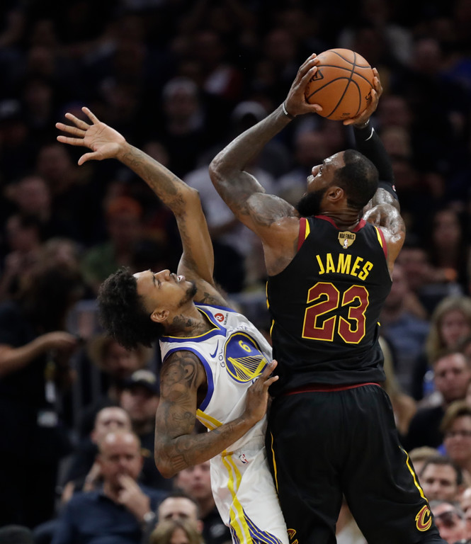 . Cleveland Cavaliers\' LeBron James shoots over Golden State Warriors\' Nick Young in the first half of Game 4 of basketball\'s NBA Finals, Friday, June 8, 2018, in Cleveland. (AP Photo/Tony Dejak)