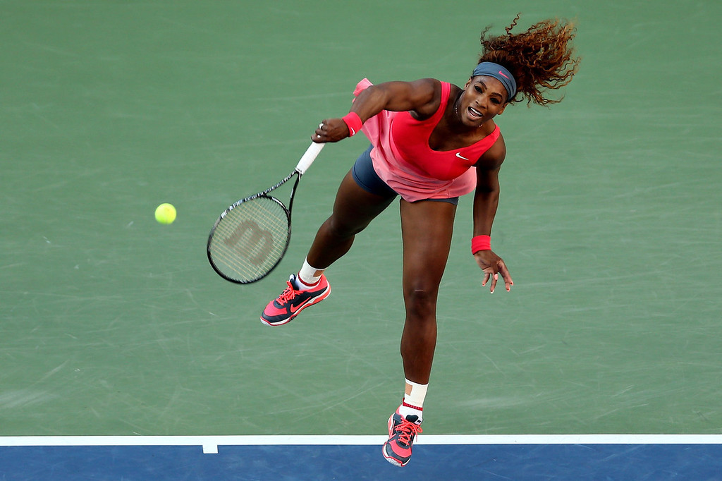. Serena Williams of the United States of America serves during her women\'s singles final match against Victoria Azarenka of Belarus on Day Fourteen of the 2013 US Open at the USTA Billie Jean King National Tennis Center on September 8, 2013 in the Flushing neighborhood of the Queens borough of New York City.  (Photo by Matthew Stockman/Getty Images)