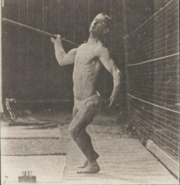 Man in pelvis cloth throwing spear