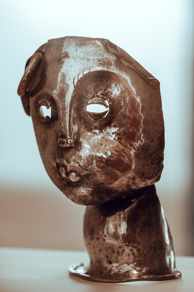 An ancient metal mask figure at the MAH Geneva