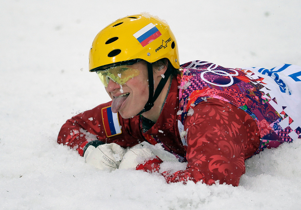 . Russia\'s Ilya Burov sticks out his tongue after crashing following his landing in the men\'s freestyle skiing aerials qualifying at the Rosa Khutor Extreme Park, at the 2014 Winter Olympics, Monday, Feb. 17, 2014, in Krasnaya Polyana, Russia. (AP Photo/Charlie Riedel)