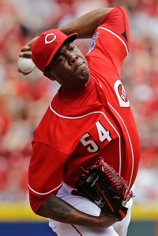 . Cincinnati Reds relief pitcher Aroldis Chapman throws against the Colorado Rockies in the ninth inning of a baseball game, Sunday, May 11, 2014, in Cincinnati. Chapman earned his first save of the year as the Reds won 4-1. Chapman was making his first appearance since being hit in the head with a line drive in spring training. (AP Photo/Al Behrman)