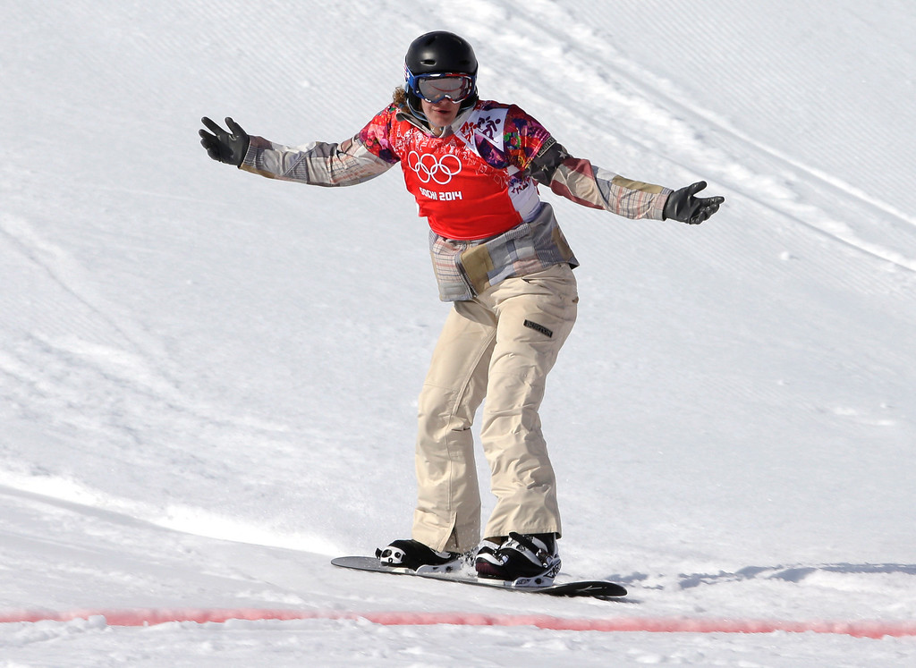 . Lindsey Jacobellis  of the United States crosses the line to win the small final of the women\'s snowboard cross at the Rosa Khutor Extreme Park, at the 2014 Winter Olympics, Sunday, Feb. 16, 2014, in Krasnaya Polyana, Russia. (AP Photo/Andy Wong)