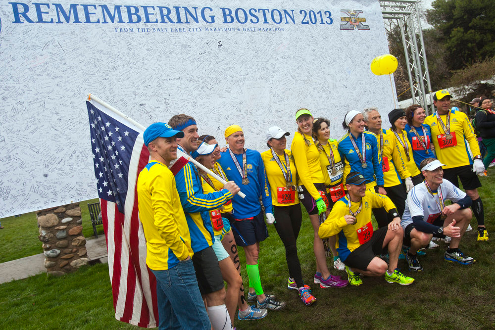 . Utahans who ran in the Boston Marathon on Monday pose for pictures after running the Salt Lake City marathon, at Liberty Park on Saturday, April 20, 2013, in Salt Lake City. The group ran at a pace Saturday to complete the rain-soaked course in 4 hours, 9 minutes, 43 seconds - the time during the Boston race when the first bomb exploded near the finish line. (AP Photo/The Salt Lake Tribune, Chris Detrick)