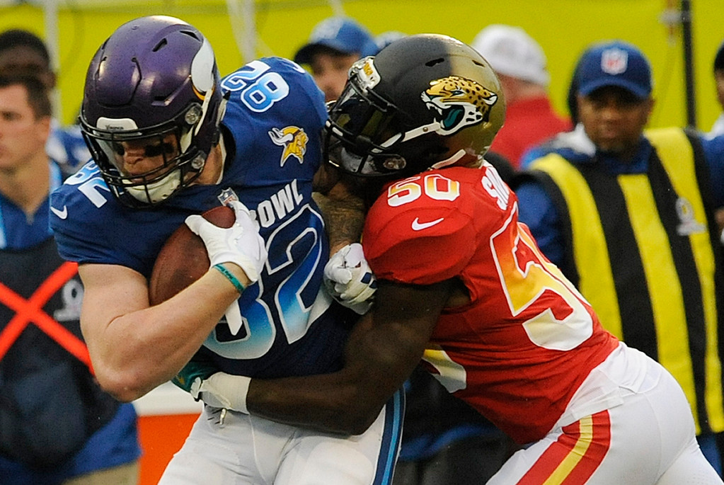 . AFC linebacker Telvin Smith (50) of the Jacksonville Jaguars, tackles, NFC tight end Kyle Rudolph (82) of the Minnesota Vikings, during the second half of the NFL Pro Bowl football game, Sunday, Jan. 28, 2018, in Orlando, Fla. (AP Photo/Steve Nesius)