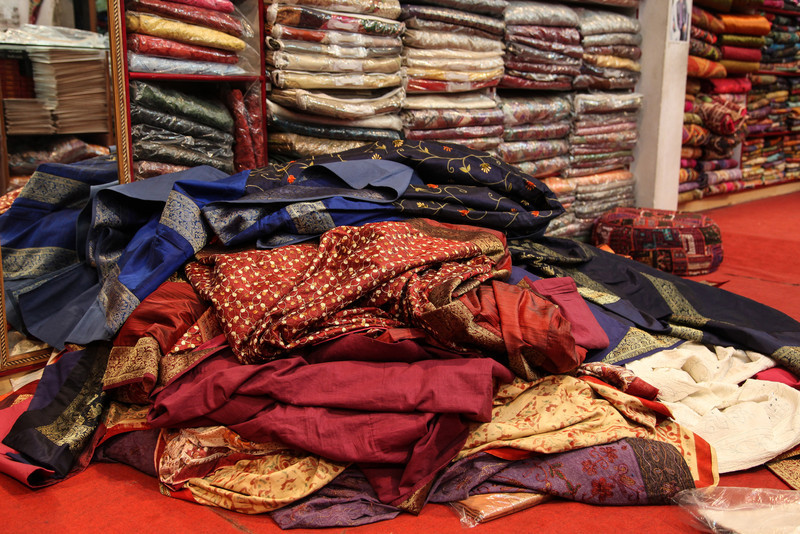 The pile of scarves and fabrics we weren't interested in.