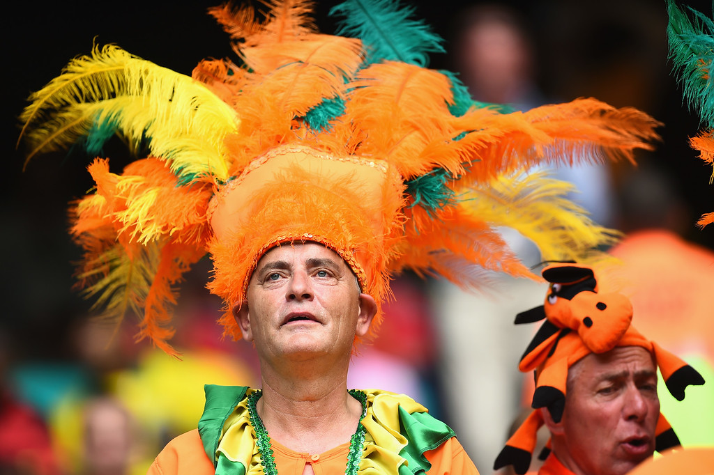 . Netherlands fans look on wearing colorful headdresses during the 2014 FIFA World Cup Brazil Group B match between Spain and Netherlands at Arena Fonte Nova on June 13, 2014 in Salvador, Brazil.  (Photo by David Ramos/Getty Images)