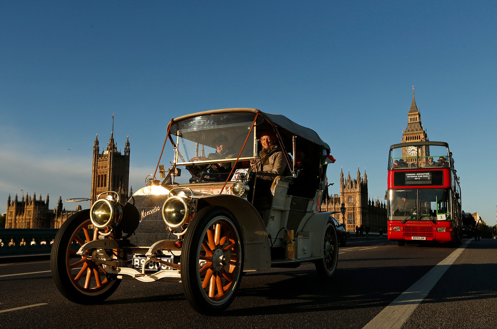 . Backdropped by the Houses of Parliament in central London, participants drive their 1904 Renault car during the London to Brighton Veteran Car Run, Sunday, Nov. 3, 2013. Over 400 pre-1905 vehicles made their way on the historic 60-mile run from Hyde Park in London to coastal Brighton in southern England, in the world\'s longest running motoring celebration spanning 117 years.(AP Photo/Lefteris Pitarakis)