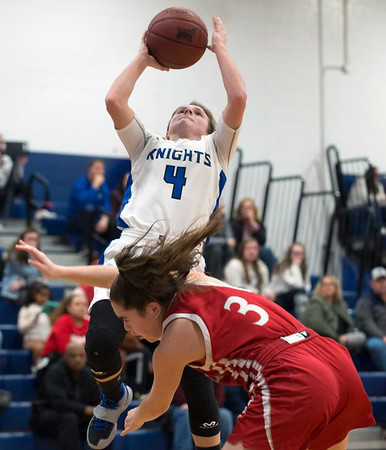 01/06/19 Wesley Bunnell | StaffrrSouthington girls basketball vs Conard on Monday night at Southington High School. Livvy Pizzitola (4) with a shot over a Conard defender.