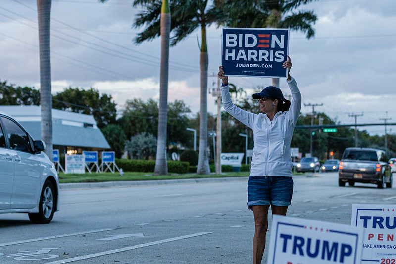 Susan Wescott of Boca Raton waves a Biden/Harris sign in front of Ascension Catholic Church in Boca Raton, on Election Day, Tuesday, November 3, 2020. (JOSEPH FORZANO / THE PALM BEACH POST)