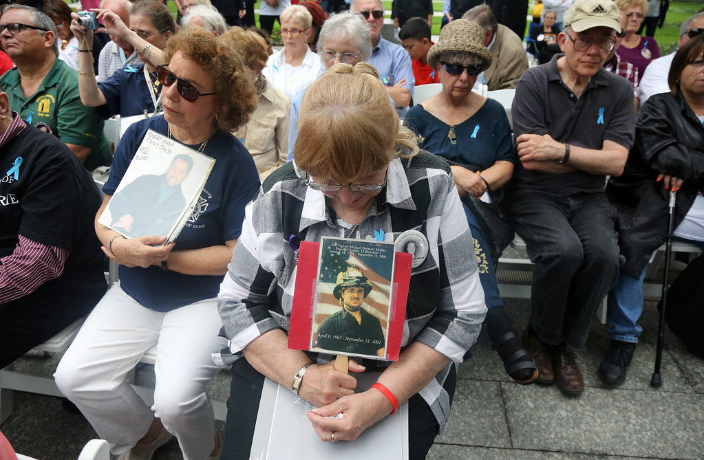 . Theresa Mullan of Bayside, Queens holds a picture of her son NYFD firefighter Micael Mullan of Ladder 12, who was killed during the Sept. 11 terror attacks on the World Trade Center, during the 13th anniversary memorial in New York, Thursday, Sept. 11, 2014.   Family and friends of those who died read the names of the nearly 3,000 people killed in New York, at the Pentagon and near Shanksville, Pennsylvania. (AP Photo/The Record of Bergen County, Chris Pedota, Pool)