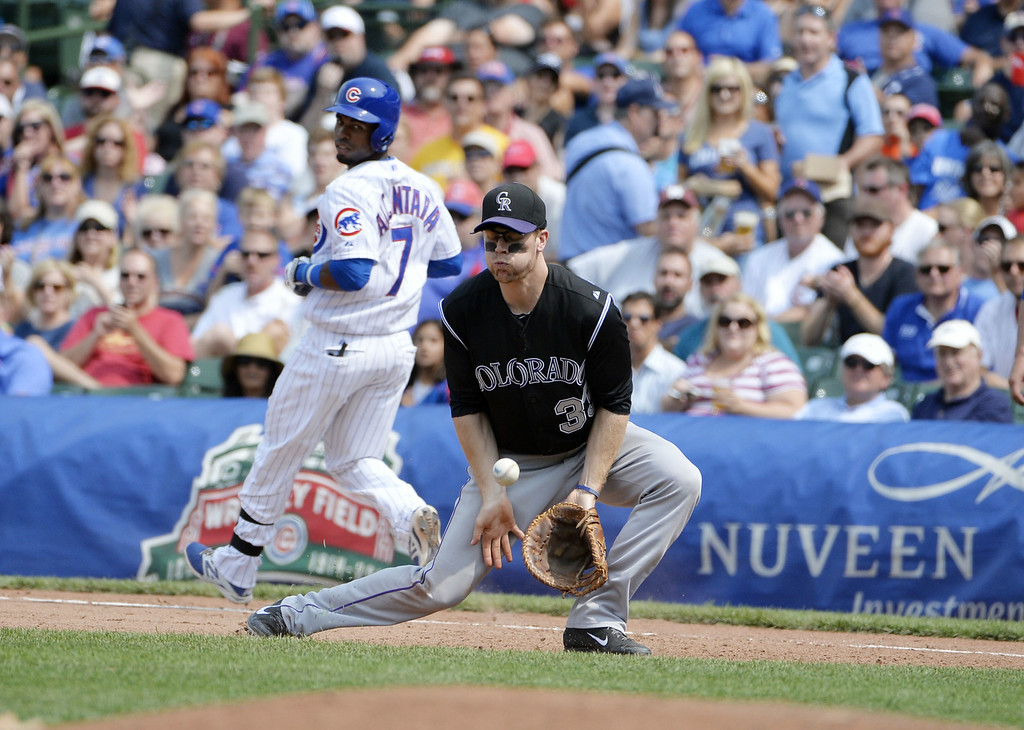 . Arismendy Alcantara #7 of the Chicago Cubs (L) beats the throw to first baseman Justin Morneau #33 of the Colorado Rockies for an infield single during the sixth inning at Wrigley Field on July 31, 2014 in Chicago, Illinois.  (Photo by Brian Kersey/Getty Images)