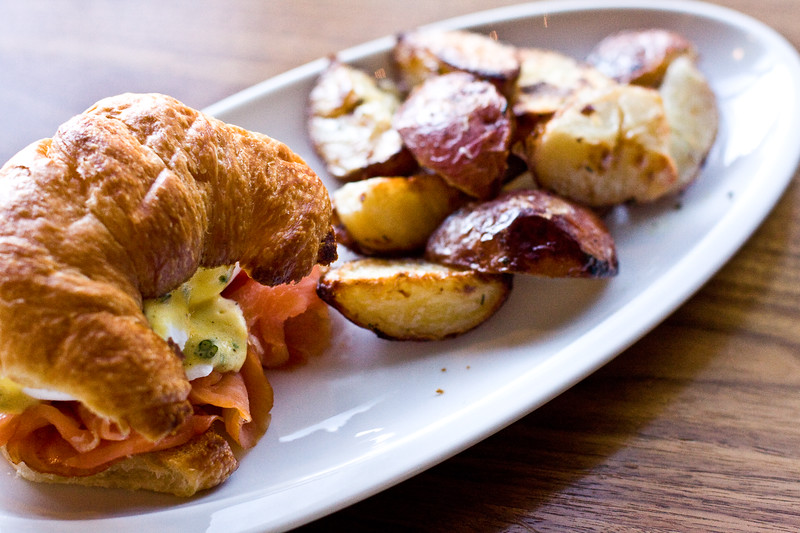 vedas-choice-poached-eggs-on-croissant-with-barnaise-and-crispy-oven-roasted-potatoes_4345317498_o.jpg