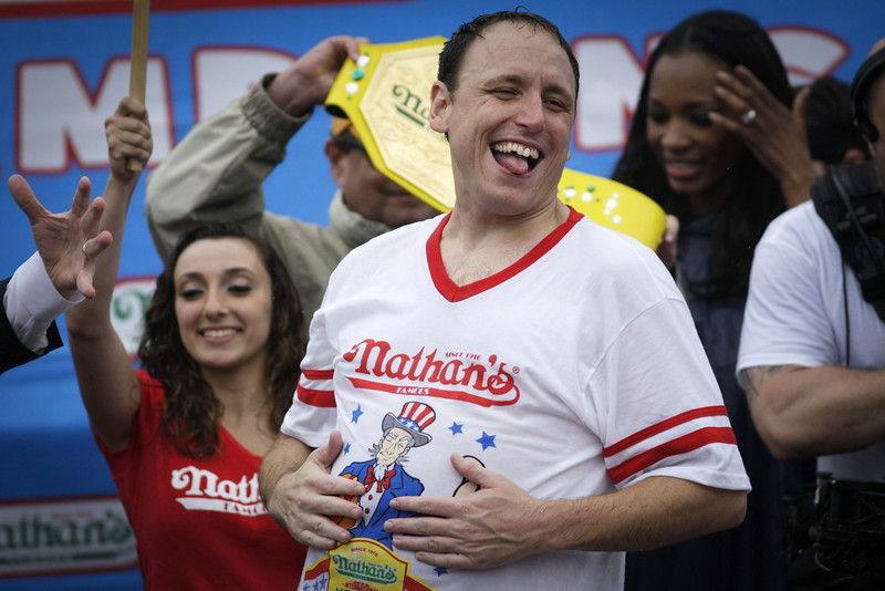 . Joey Chestnut celebrates after winning the 98th annual Nathan\'s Famous Hot Dog Eating Contest at Coney Island on July 4, 2014 in the Brooklyn borough of New York City.  Chesnut won his eighth straight Nathan\'s Hot Dog Eating Contest with 61 hot dogs. (Photo by Kena Betancur/Getty Images)
