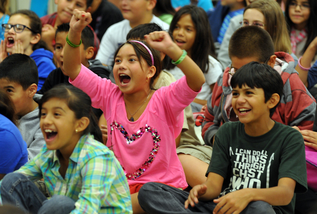 . Students cheer as Country Western singer Lizzie Sider, 15, sings during her 80-school California Bully Prevention Tour for students at Ocean View Elementary School in Whittier on Monday November 4, 2013. (Whittier Daily News/Staff Photo by Keith Durflinger)
