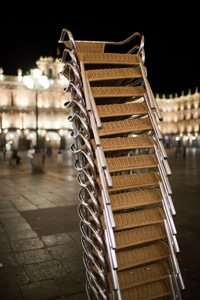 Piles of chairs after the restaurant closing time, Plaza Mayor (Main Square), town of Salamanca, autonomous community of Castilla and Leon, Spain
