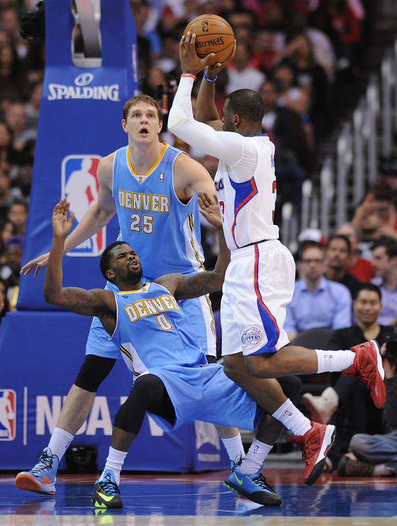 . Denver#0 Aaron Brooks takes a charge from Clippers#3 Chris Paul in the second half. The Los Angeles Clippers defeated Denver Nuggets 117 to 105 in a regular season NBA game. Los Angeles, CA. 4/15/2014(Photo by John McCoy / Los Angeles Daily News)