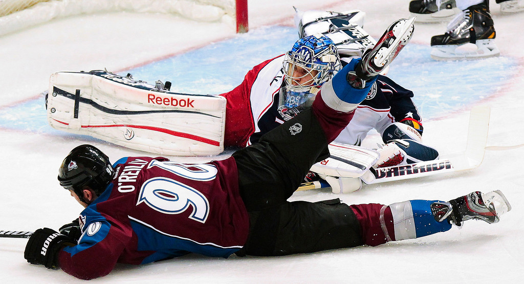 . Colorado Avalanches\' Ryan O\'Reilly (90) slides in front of Columbus Blue Jackets goalie Sergei Bobrovsky (72), of Russia, during the first period of an NHL hockey game, Monday, April 15, 2013, in Denver. (AP Photo/Barry Gutierrez)