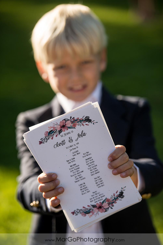 little boy with wedding ceremony flyer at San Diego Marina Village
