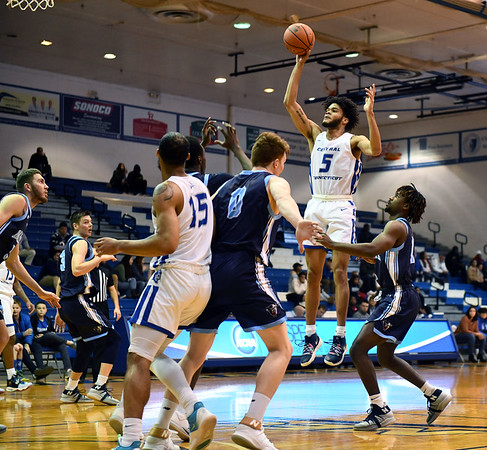 12/7/2019 Mike Orazzi | StaffrCCSU's Xavier Wilson (5) during Saturday's mens basketball game with the University of Maine in New Britain.