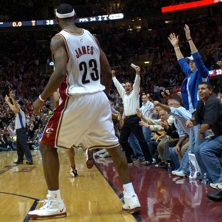 . MORNING JOURNAL/DAVID RICHARD LeBron James faces the Quicken Loans Arena crowd after making a 3-point shot from the corner as time expired in the first half.