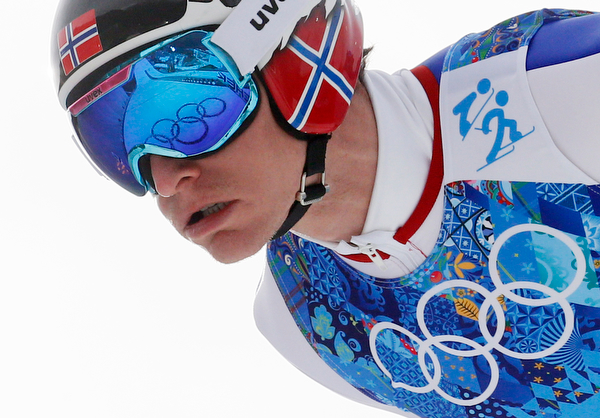 . THe Olympic rings are reflected in the goggles of Norway\'s Haavard Klemetsen as he makes his attempt during the ski jumping portion of the Nordic combined Gundersen large hill team competition at the 2014 Winter Olympics, Thursday, Feb. 20, 2014, in Krasnaya Polyana, Russia. (AP Photo/Dmitry Lovetsky)
