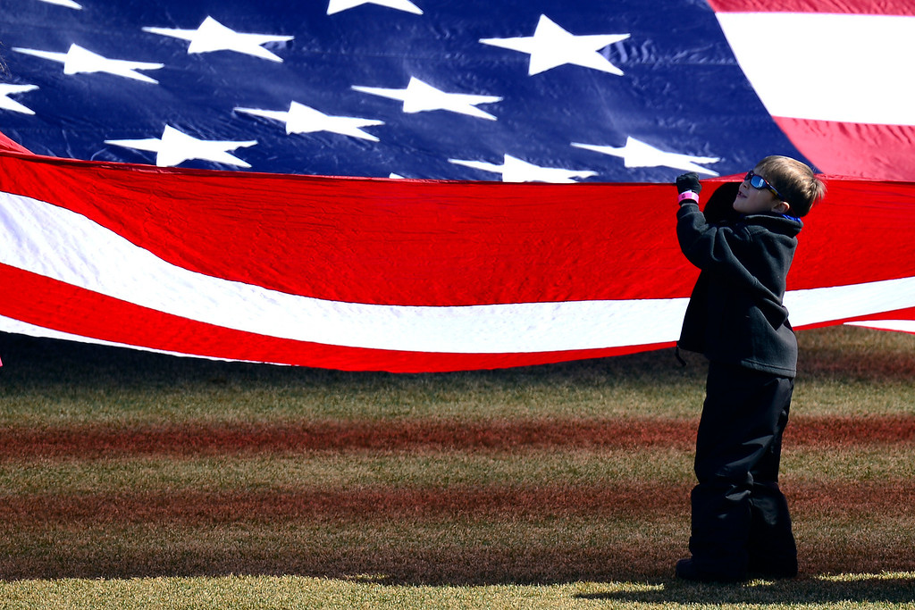 . COMMERCE CITY, CO - MARCH 10: Children help hold the flag during pre-game ceremonies. The Colorado Rapids play the Philadelphia Union at Dick\'s Sporting Goods Park. (Photo By AAron Ontiveroz/The Denver Post)