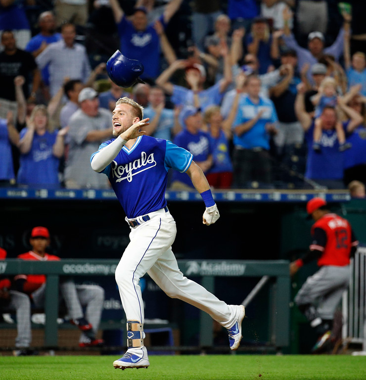 . Kansas City Royals\' Hunter Dozier celebrates after hitting a walk-off home run in the team\'s baseball game against the Cleveland Indians on Friday, Aug. 24, 2018, in Kansas City, Mo. The Royals won 5-4. (AP Photo/Charlie Riedel)