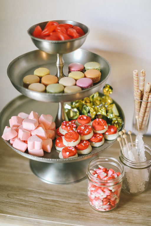 Sweets table at floral and unicorn themed party in Washington, DC.