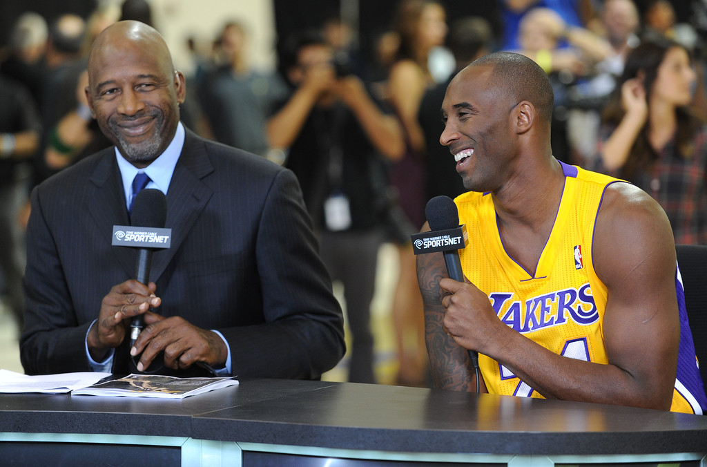 . Former Laker James Worthy interviews Kobe Bryant.The Los Angeles Lakers held a media day at their El Segundo practice facility. Players were photographed for team materials, and interviewed by the press. El Segundo, CA. 9/27/2013. photo by (John McCoy/Los An8eles Daily News)