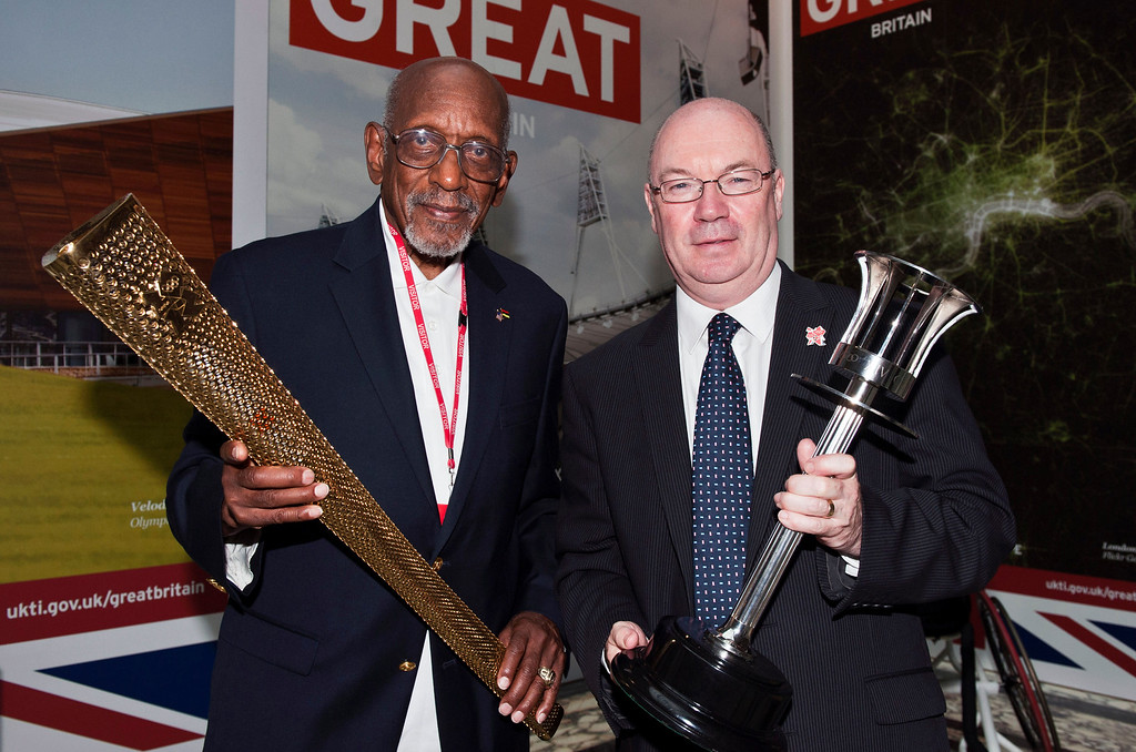 . US former athlete Harrison Dillard, left, the oldest living 100 metre gold medalist, poses with British Government Minister Alistair Burt, in London, Wednesday, Aug. 1, 2012.  Britain\'s Foreign Office honored the 89-year-old American in London on Wednesday and allowed Dillard to hold the 1948 Olympic torch again. (AP Photo/ Will Oliver, Pool)