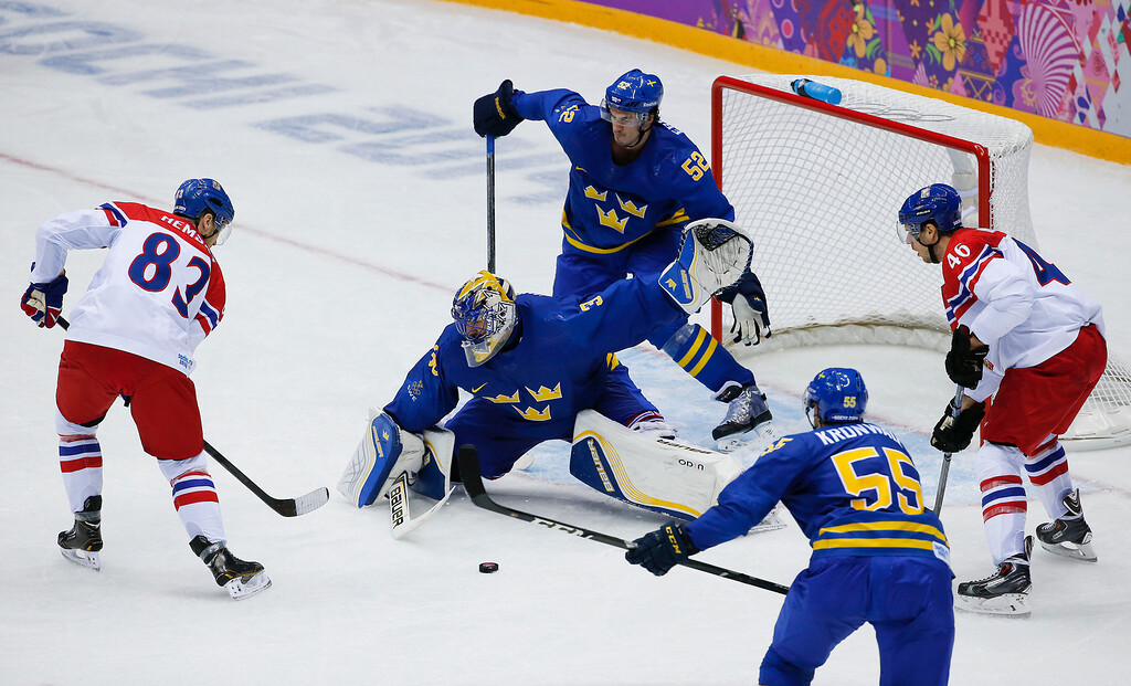 . Sweden goaltender Henrik Lundqvist blocks a shot on goal by Czech Republic forward Ales Hemsky in the third period of a men\'s ice hockey game at the 2014 Winter Olympics, Wednesday, Feb. 12, 2014, in Sochi, Russia. (AP Photo/Julio Cortez)