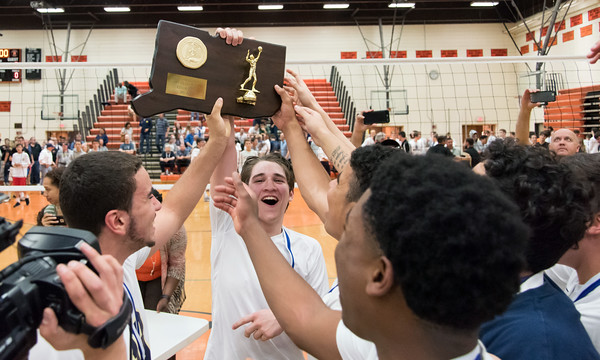 06/07/18 Wesley Bunnell | Staff Newington volleyball defeated Joel Barlow on Thursday night at Shelton High School to claim the Class M State Championship. Evan Metzger (3) holds the championship plaque.