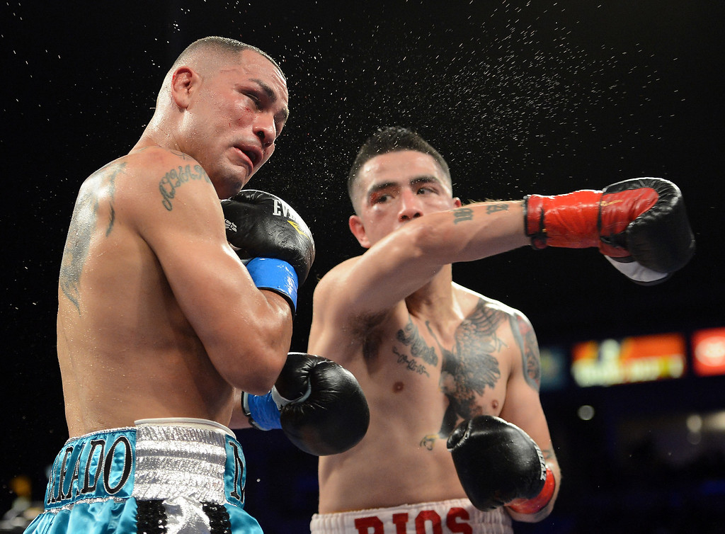 . 2. Mike Alvarado vs. Brandon Rios. The first meeting between Rios and Alvarado, in October of 2012, ended with Alvarado taking the first loss of his career, by TKO in seven rounds, but set the stage for one of the sport�s most entertaining rivals in recent years. The two traded brutal punch after brutal punch, and SI.com named it the Fight of the Year.  (Photo by Harry How/Getty Images)