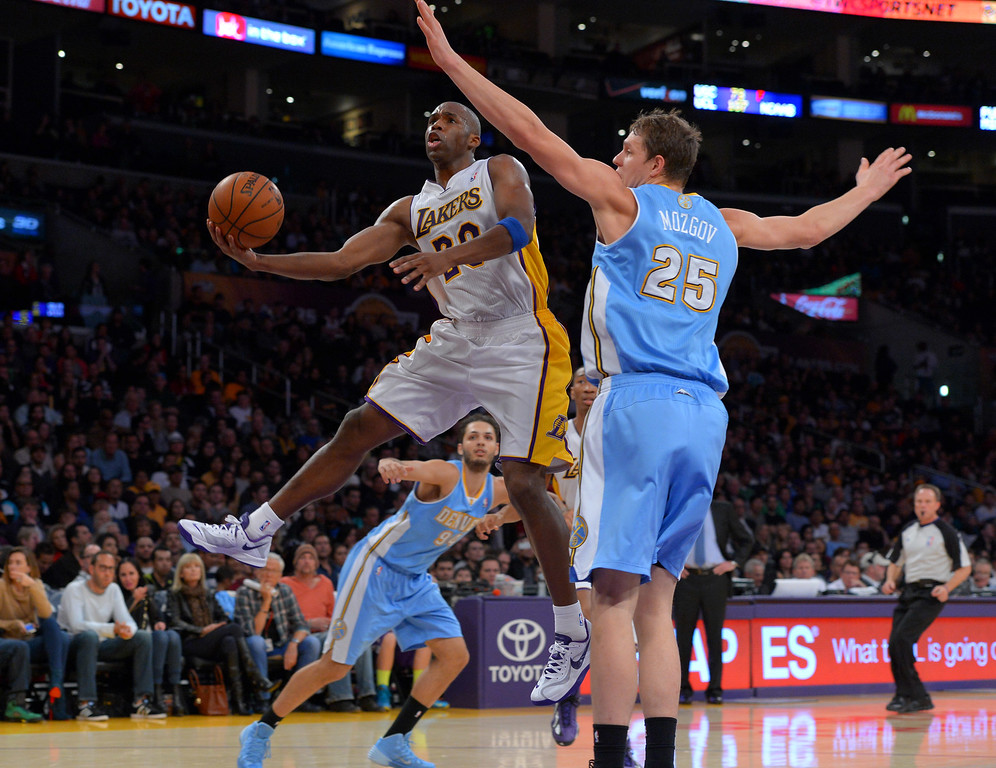 . Lakers Jodie Meeks scores against the Nuggets\' Timofey Mozgov at the Staple Center in Los Angeles, CA on Sunday, January 5, 2014. 1st half.  (Photo by Scott Varley, Daily Breeze)
