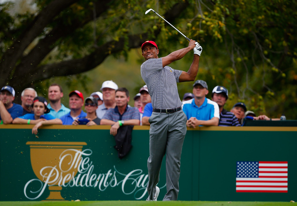 . DUBLIN, OH - OCTOBER 04:  Tiger Woods of the U.S. Team watches his tee shot on the fourth hole during the Day Two Foursome Matches at the Muirfield Village Golf Club on October 4, 2013  in Dublin, Ohio.  (Photo by Matt Sullivan/Getty Images)