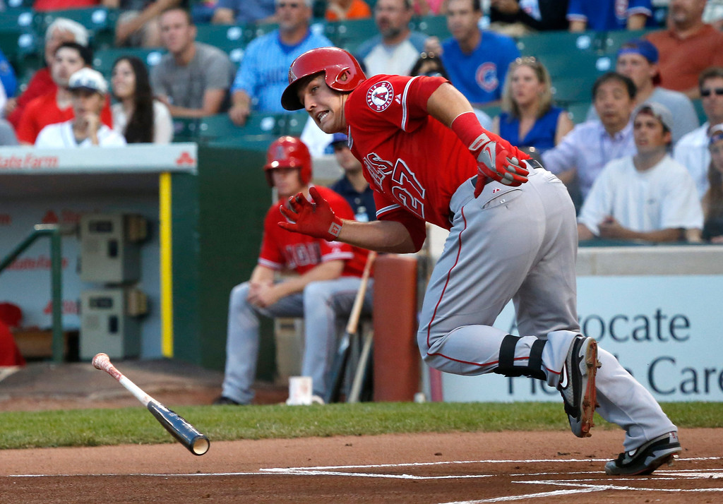 . Los Angeles Angels\' Mike Trout hits an RBI double off Chicago Cubs starting pitcher Jeff Samardzija, scoring Erick Aybar, during the first inning of an interleague  baseball game Wednesday, July 10, 2013, in Chicago. (AP Photo/Charles Rex Arbogast)