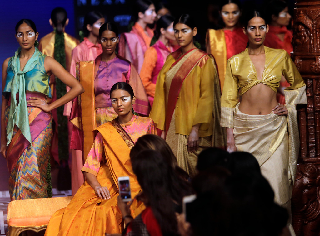 . Models showcase the creation of designer Sunita Shanker during Lakme fashion week winter 2018 in Mumbai, India, Thursday, Aug. 23, 2018. (AP Photo/Rajanish Kakade)