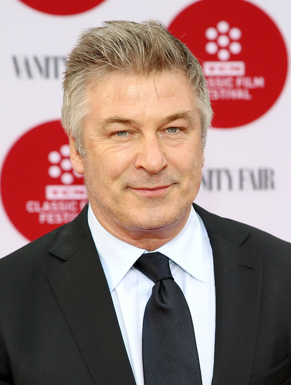 ". In this April 10, 2014 file photo, Alec Baldwin arrives 2014 TCM Classic Film Festival\'s Opening Night Gala at the TCL Chinese Theatre in Los Angeles. Canadian actress Genevieve Sabourin was convicted in November 2013 of stalking Baldwin with emails, phone calls, and unsolicited visits to his Manhattan apartment. Sabourian and Baldwin met in 2000 on a movie set and had dinner a decade later, and the actress said Baldwin made promises of a life together. The judge who sentenced her said no matter what happened between the two, Sabourin had no right to pursue contact she knew to be unwanted and amounted to a ""relentless and escalating campaign of threats and in-person appearances.\"" (Photo by Annie I. Bang /Invision/AP, file)"