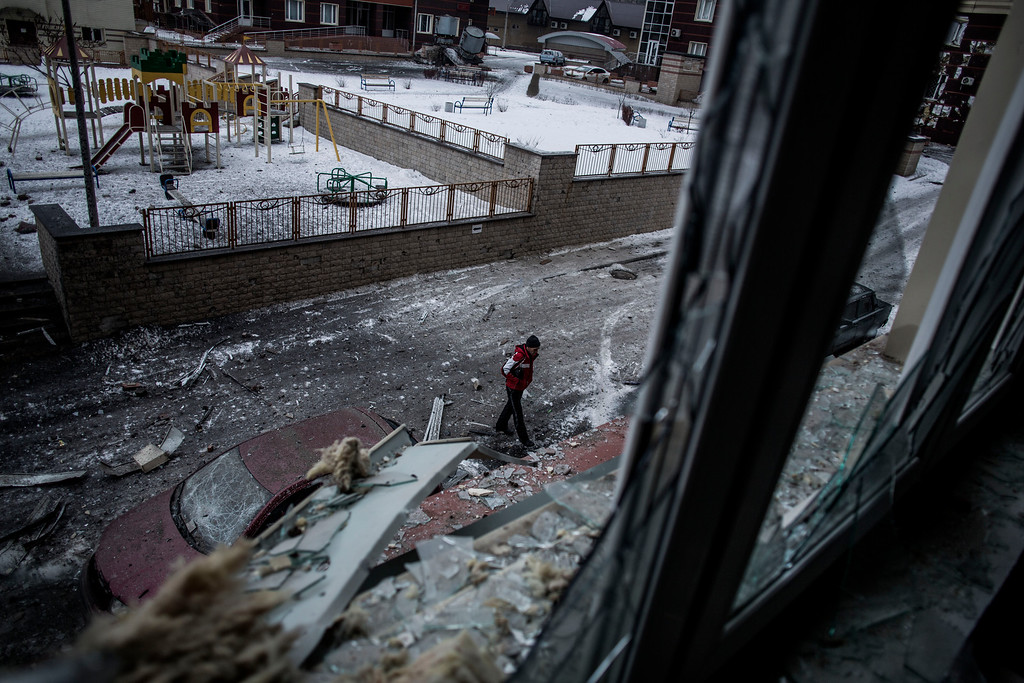 . A Ukrainian man walks through the debris produced after the Ukrainian Army hit a building in Voroshilovsky area, center of Donetsk, Ukraine. Sunday, Jan. 18, 2015. The separatist stronghold, Donetsk, was shaken by intense outgoing and incoming artillery fire as a bitter battle raged for control over the city\'s airport. Streets in the city, which was home to 1 million people before unrest erupted in spring, were completely deserted and the windows of apartments in the center rattled from incessant rocket and mortar fire. (AP Photo/Manu Brabo)