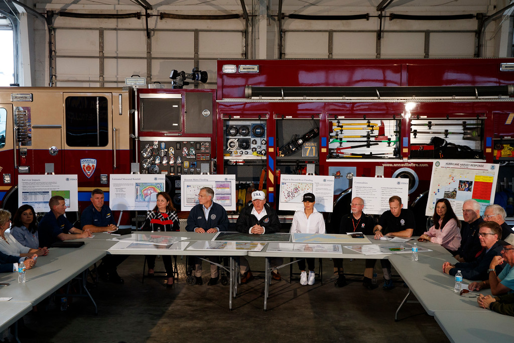 . President Donald Trump, accompanied by, from left, center table, acting Homeland Security Secretary Elaine Duke, Texas Gov. Greg Abbott and first lady Melania Trump, participates in a briefing on Harvey relief efforts, Tuesday, Aug. 29, 2017, in Corpus Christi, Texas. (AP Photo/Evan Vucci)