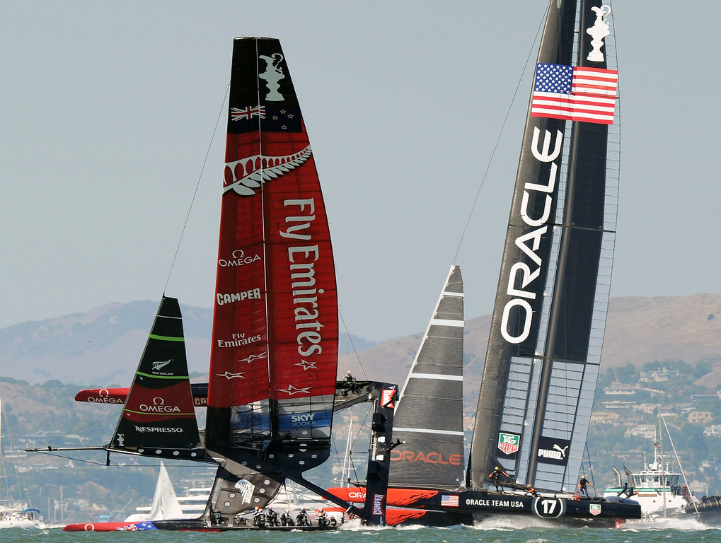 . Emirates Team New Zealand (L) competes against Oracle Team USA during the 34th America\'s Cup on September 14, 2013 in San Francisco.   DON EMMERT/AFP/Getty Images